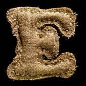 Linen or hemp vintage cloth letter E — Stock Photo