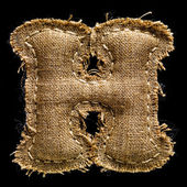 Linen or hemp vintage cloth letter H — Stock Photo