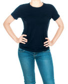 Girl in a black T-shirt and jeans on isolated background — Stock Photo