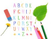 Pencils and eraser on the background of the alphabet — Stock Photo