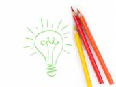 Set of four colorful crayons drawing light bulb, business idea — Foto de Stock