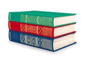 Stack of vintage red, green and blue books on white isolation — Stockfoto