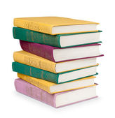 Stack of colorful books in the textile cover on isolated white — Stockfoto