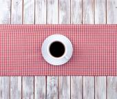 Coffee cup top view on  wooden and tissue — Stockfoto