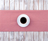 Coffee cup top view on  wooden and tissue — Stock Photo