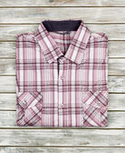 Shirt on a wooden background — Stock Photo