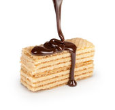 On vanilla wafer pouring chocolate on white background — Foto Stock
