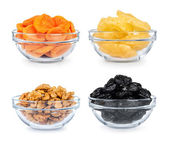 Collection of dried fruit in a glass bowl on a white background — Stock Photo