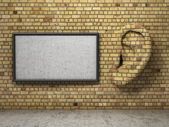 Ear in tte wall with banner. Listening concept. — Stock Photo