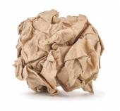 Kraft paper crumpled into a ball on a white background — Stock Photo