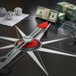 Conceptual image of compass directing at money. Course concept. — Stock Photo #67333633