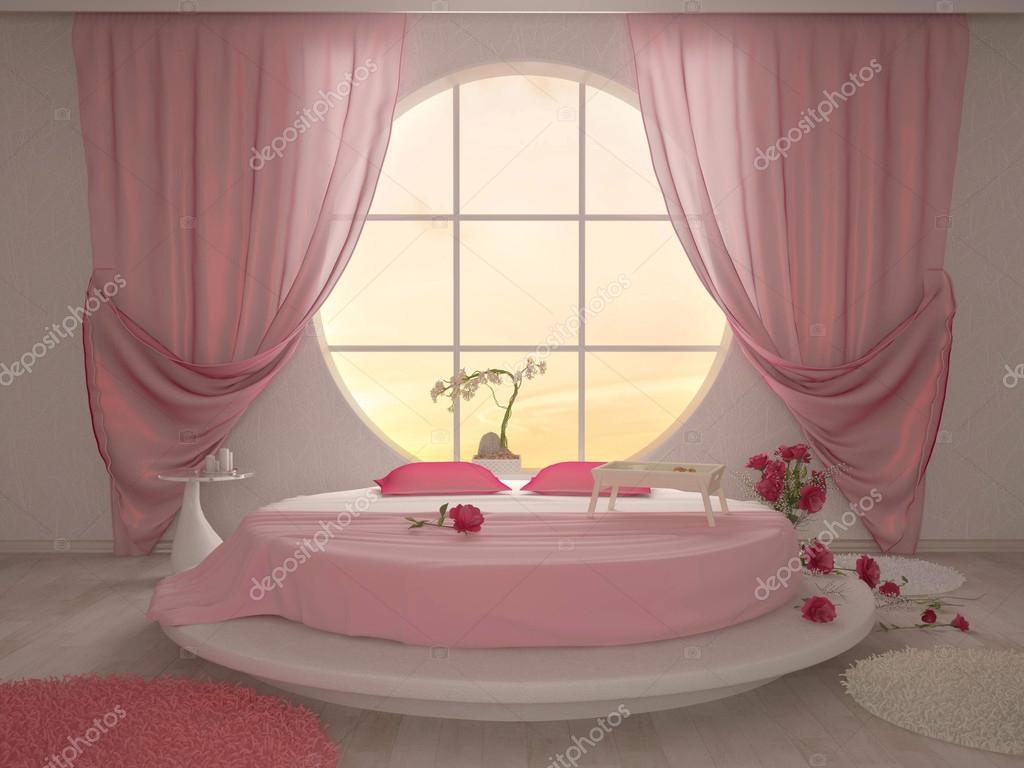 Sovrum med en cirkulär fönster och en rund säng i rosa ...