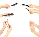Set of hands holding a pair of scissors, a comb and nail file on — Stock Photo