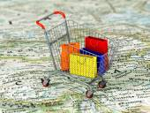 International shopping. Colorful package in the shopping cart on — Stock Photo