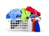Clothes with detergent and in  plastic basket dropped isolated o — Stock Photo