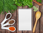 Spices recipe background. Variety of condiments with recipe shee — Stock Photo