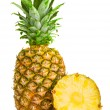 Fresh pineapple fruits with cut and green leaves isolated on whi — Stock Photo #61966021