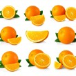Set of ripe orange fruits with leaves and slices isolated on whi — Stock Photo #64390385