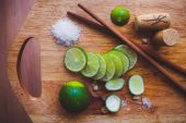 Lime slices, sugar, cork and Chinese sticks — Stock Photo