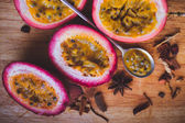 Passion fruit pulp and seed board, spoon, spices — Stock Photo