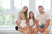 Happy toung family with kids at home — Stock Photo
