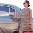 Lady standing near retro car — Stock Photo #52405887