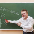 Student boy standing near the blackboard — Stock Photo #52489679
