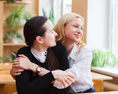 Student girls during a brake between classes - chatting and havi — Stock Photo
