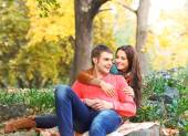 Portrait of couple enjoying golden autumn fall season — Stock Photo