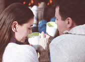 Couple holding cups with hot chocolate with marshmallows — Stockfoto