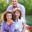 Happy family with daughter on autumn picnic — Stock Photo #54750325