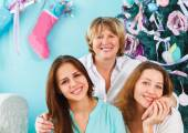 Mature mother and adult daughter and teen granddaughter near the — Stock Photo