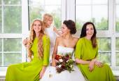 Cheerful bride with female friends and little flower girl — Foto Stock