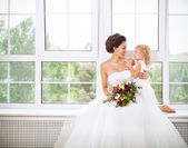 Smiling happy bride and a flower indoors — Stock Photo