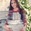 Beautiful young teen girl with Christmas presents — Stock Photo #56414745