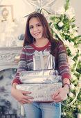 Beautiful young teen girl with Christmas presents — Stock Photo