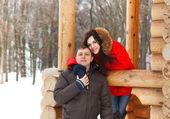 Happy couple having fun in the winter park — Stock Photo