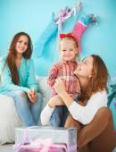Portrait of a mother with baby daughter and teen daughter near t — Stock Photo
