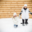 Happy mother with her daughter in a winter day — Stock Photo #57270523