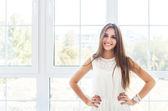 Portrait of smiling brunette tenager girl — Stock Photo