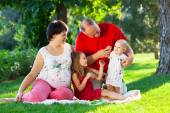 Happy family with two children in the park — Stock Photo