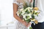 Bride holding wedding bouquet. Close up — Stock Photo