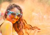 Happy young girl on holi color festival — Stock Photo