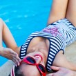 Beautiful pin up girl near the swimming pool — Stock Photo #62100053