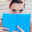Beautiful pin up girl reading the book near the swimming pool — Stock Photo #62100059