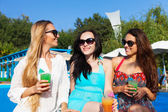 Girls with beverages on summer party near the pool — Stock Photo