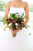 Unusual wedding bouquet with succulent flowers at hands of a bri — Stock Photo