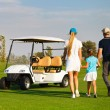 Young sportive family playing golf  — Stock Photo #62608605