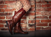 Female legs in high brown leather boots  — Stock Photo