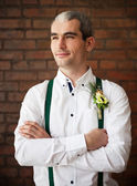 Groom wearing buttonhole with white anemone  — Stock Photo